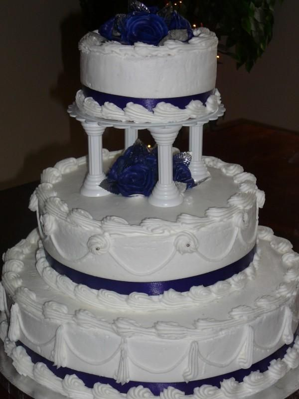 Two Stacked Tiers One Pillared Blue Satin Ribbon Around The Bottom Edges Decorated Wedding Cakesvintage