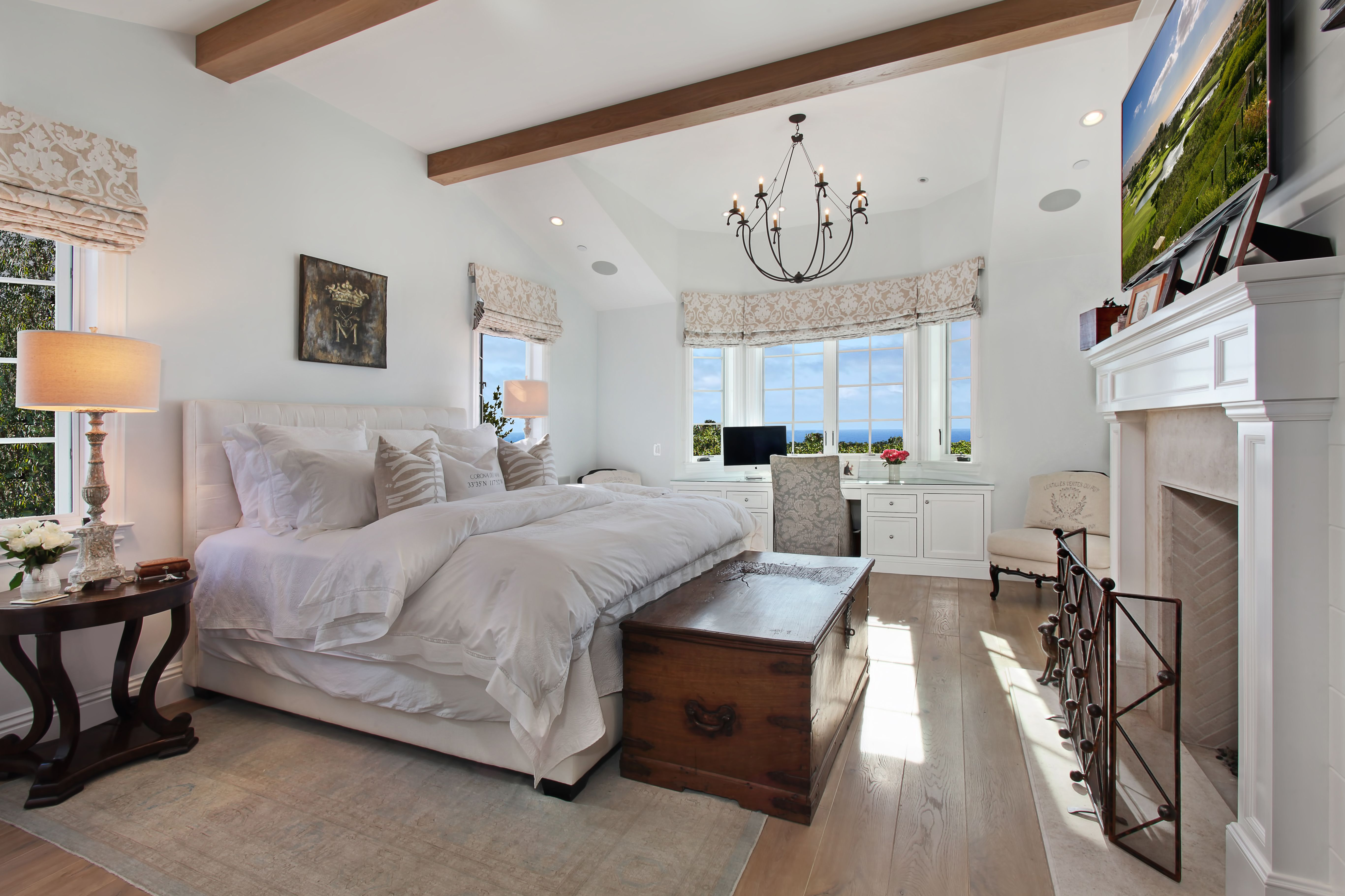 The Oak Floors Beamed Ceiling And Bay Window With An Ocean View Make This One Unforgettable Ma Condo Living Room Bedroom Window Design Hotel Style Bedroom