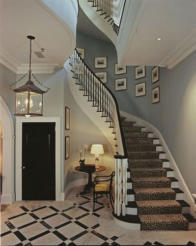 High Gloss Black Door, Marble Floors, Leopard Stair Runner, Lantern, Stairs    LOVE IT!