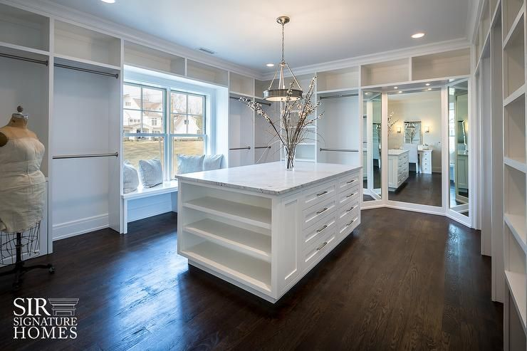 Gorgeous Boutique Style Large Walk In Closet Boasts A White Modular System Complete With Window Seat Framed By Floor To Ceiling Built