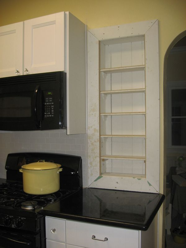 Original Spice Shelves. New upper cabinet to accommodate microwave.