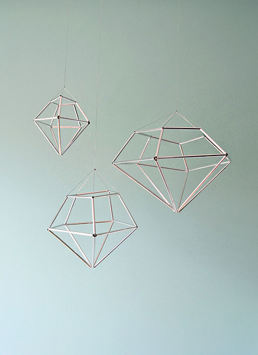 Made from straws! I would just use metallic spray paint instead of tape though. :: DIY hanging diamond decor from contributor