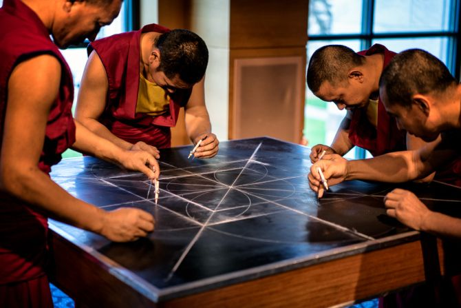 Sacred Geometry: Tibetan Week at Emory University. Using smaller compasses, they continued to add guidelines for the full drawing.
