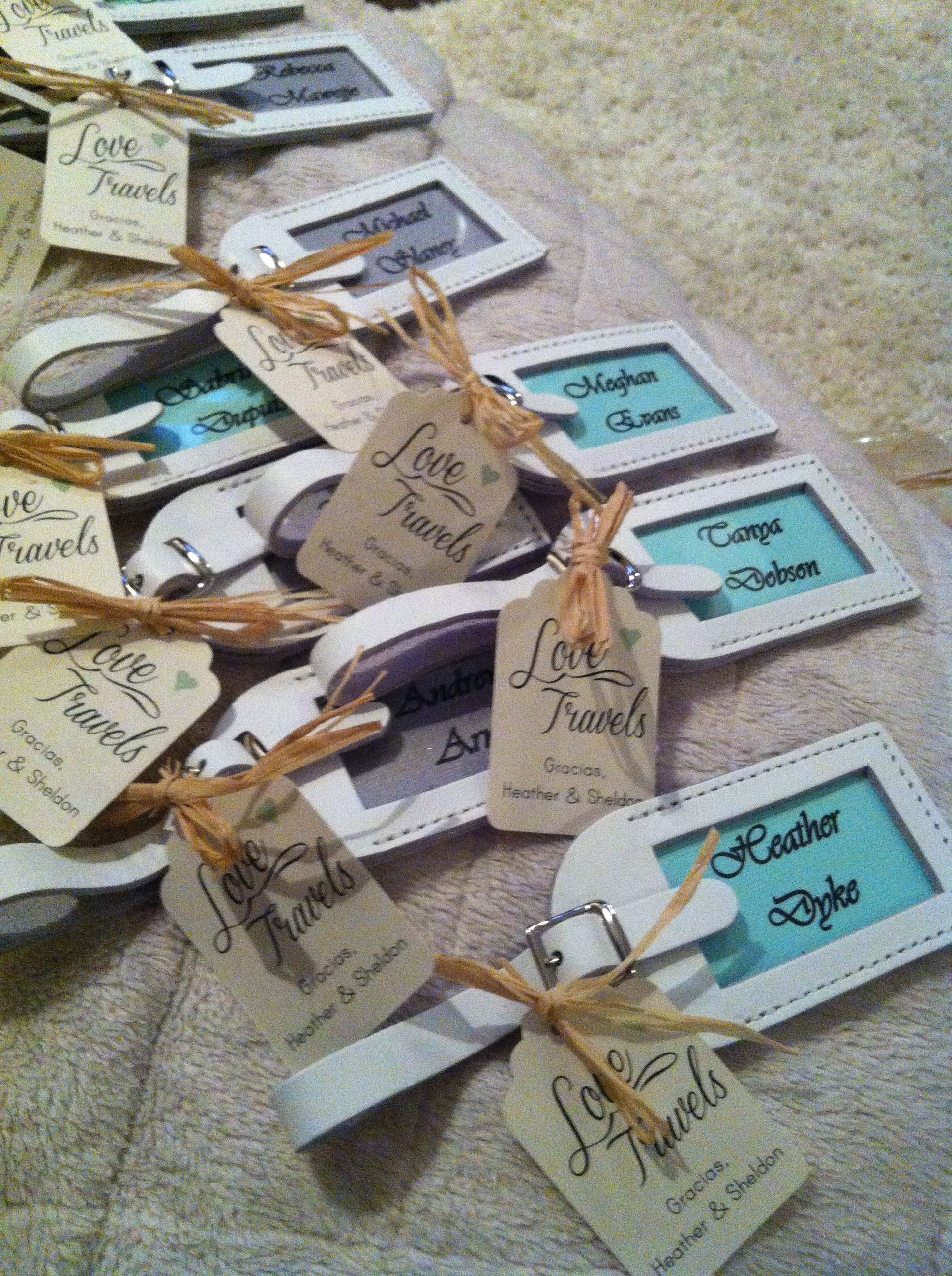 Destination wedding favors and place settings. Mint green and silver. White leather luggage tags.