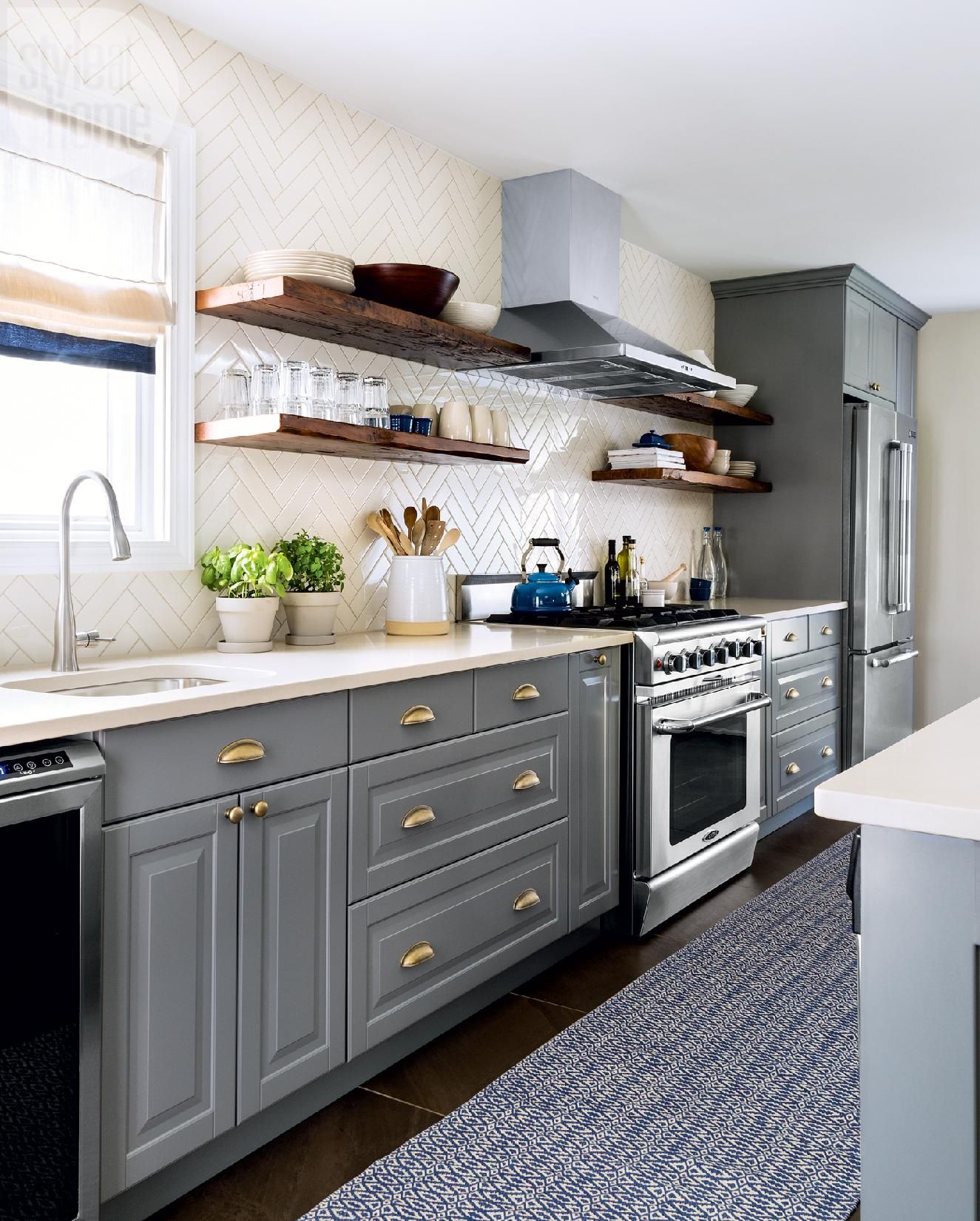 After: Sleek and spacious design - Narrow and outdated kitchen gets a sleek and spacious renovation