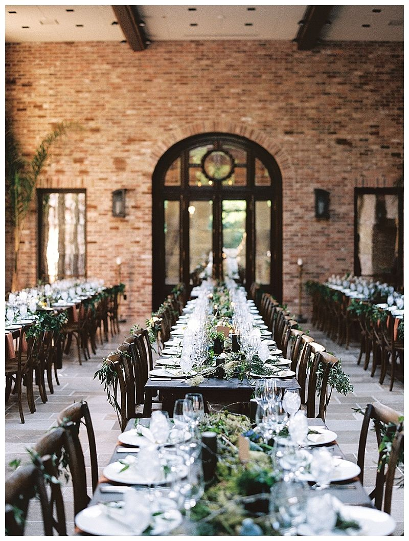 Wedding Reception With Long Rows Of Dark Wood Tables Set Rustic X Back Chairs