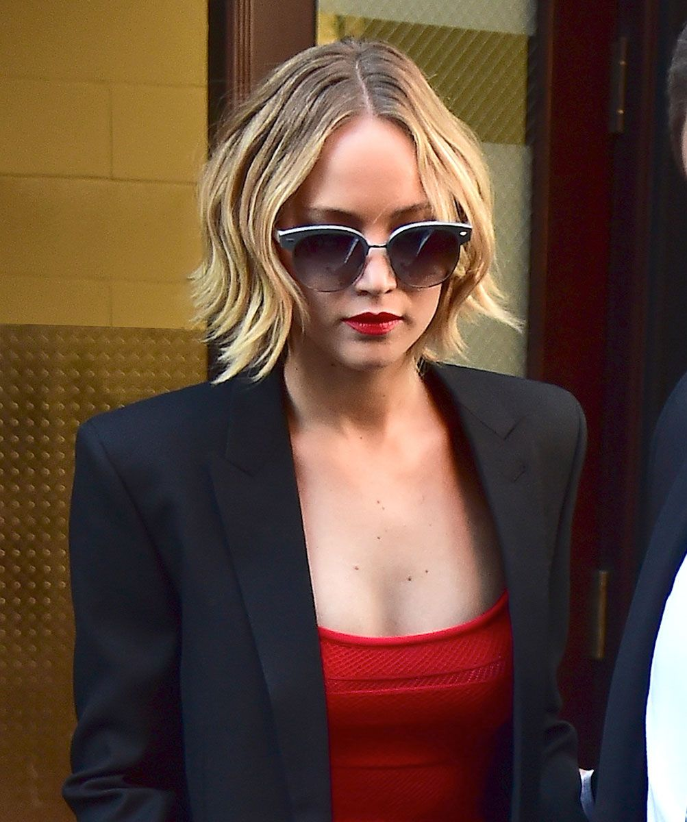Jennifer Lawrence. Red lips and tank. Black blazer and sunglasses..tied together with blonde wispy locks.