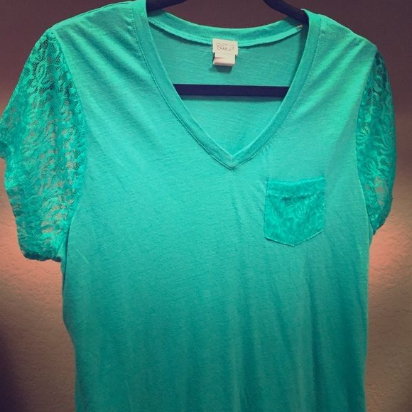 Lacey tee Gently used lacy tee from Charming Charlie. The color is very much in the real and turquoise family.  Front pocket is lace and so are the short sleeves. Pet free and smoke free home. Charming Charlie Tops Tees - Short Sleeve
