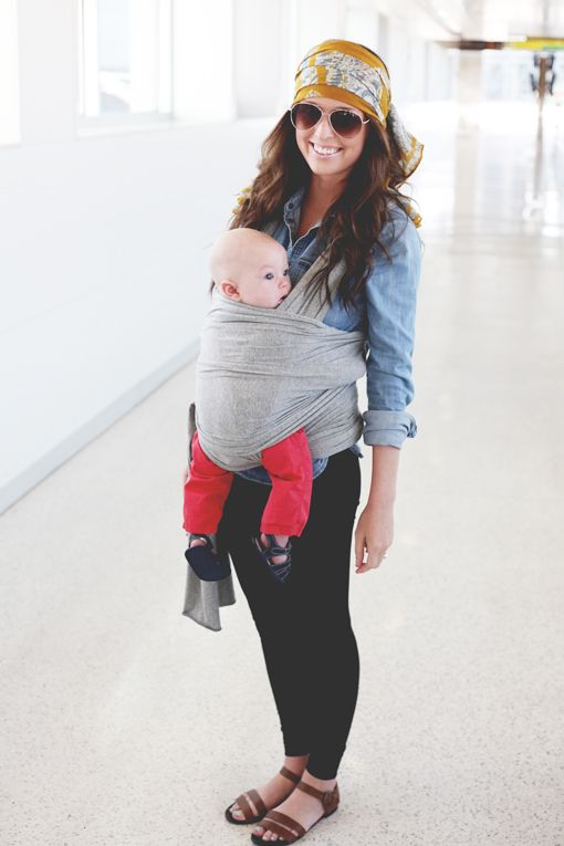 Although the baby is hanging a tad bit low (you should always be able to kiss their forehead) it's still really cute :) You can be stylish and babywear!