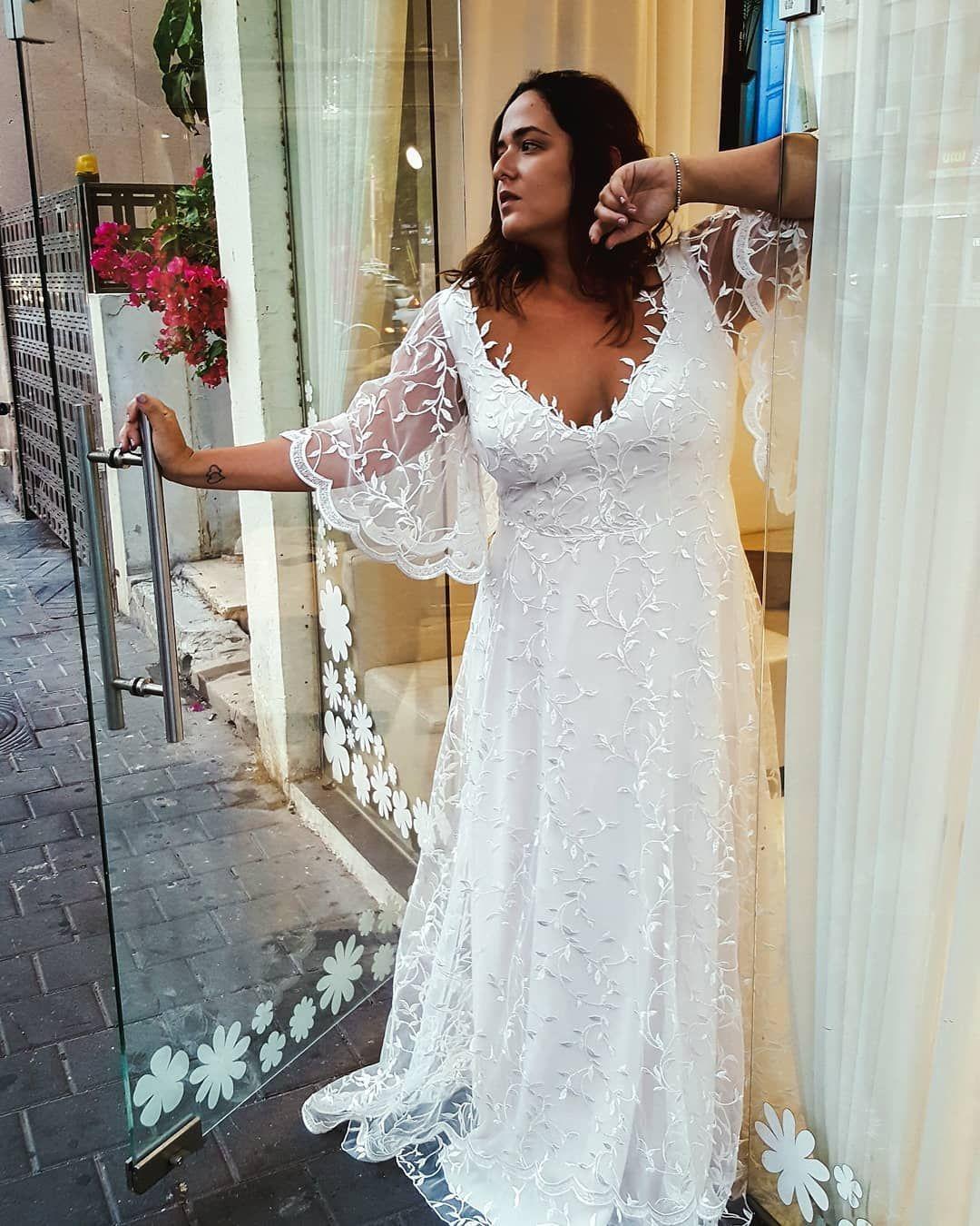 Beautiful flowy plus size wedding dress with flutter bell