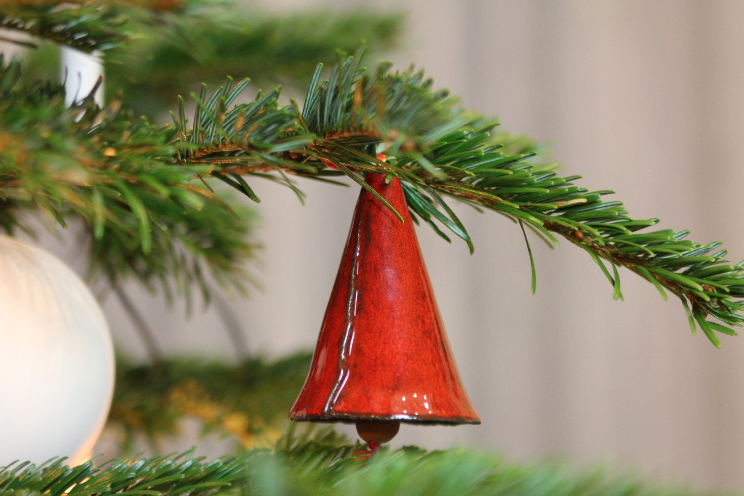 The bell is pottery by hand gang burned to hang out with red