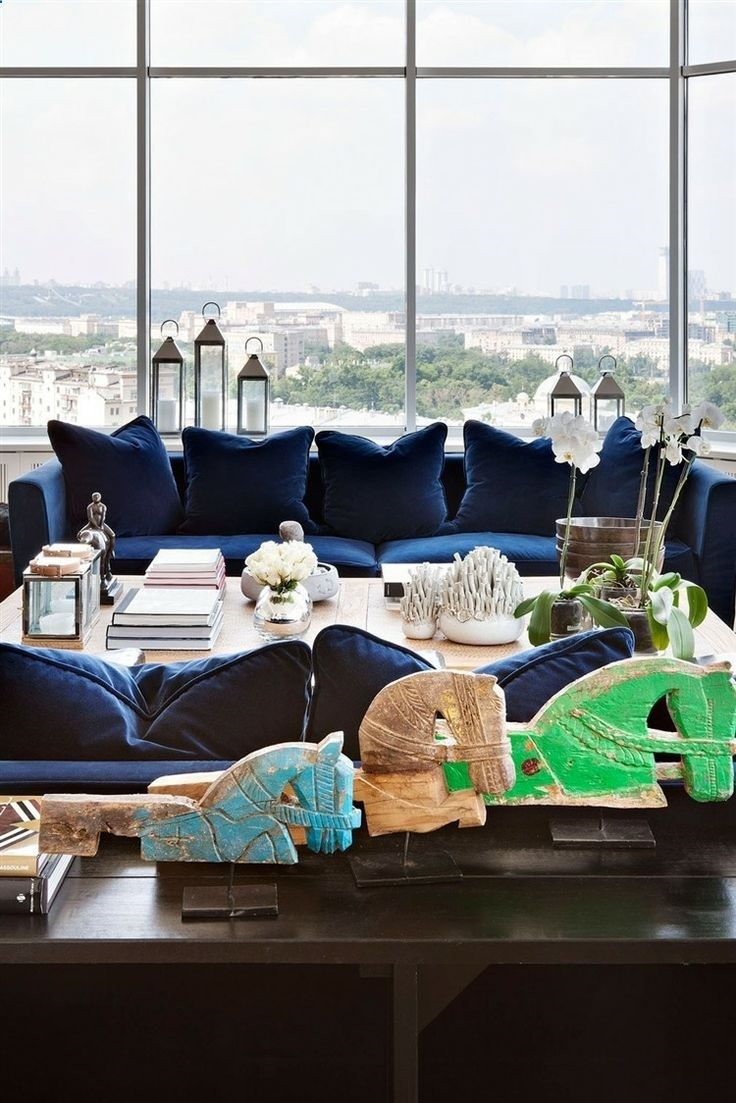 Moscow Apartment by Ksenia Nikitina, obsessed with the dark blue couches