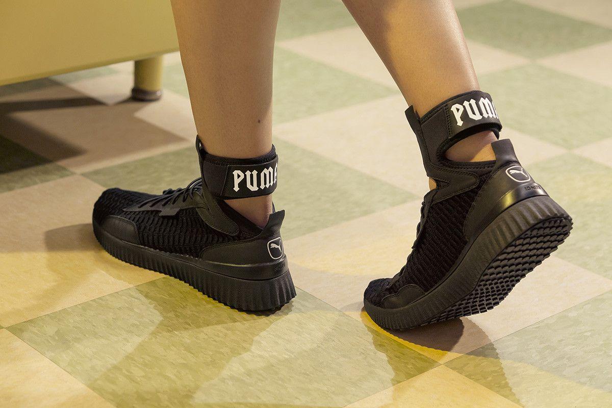 b20f28f12ba3 Rihanna Debuts All-New FENTY PUMA Trainer Mid Sneaker