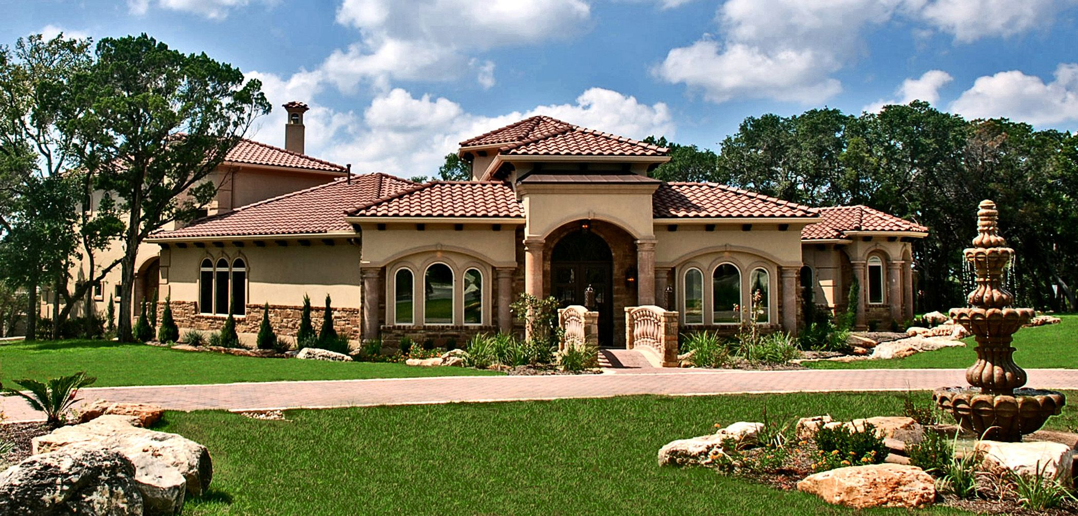 Lakeway texas tuscan front elevation by zbranek holt for Custom mediterranean homes