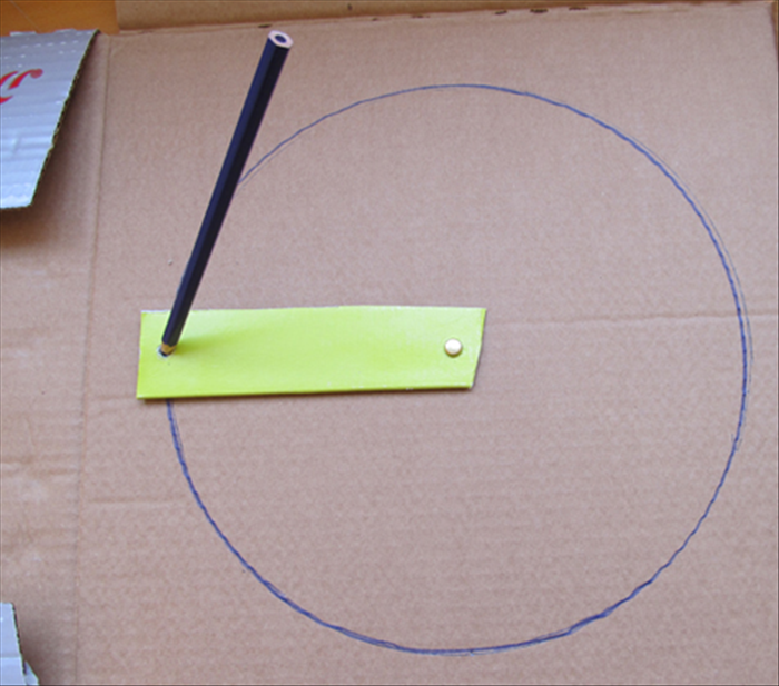 Use The Paper Fastener To Attach One End Of The Cardboard Strip To The Center Of The Cardboard You Want To Draw On Circle Drawing Circle Geometry Stencil Diy