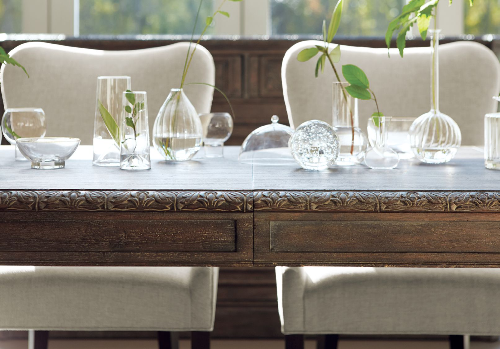 Taking inspiration from an antique table unearthed during our travels, the extendable Barnett Dining Table boasts artisanal craftsmanship and beautiful hand-carved detailing. Its design pays homage to the 19th-century industrial-era architecture found in Mechelen, Belgium. #DiningRoom #HomeDecor #Wood #Furniture #Handcrafted