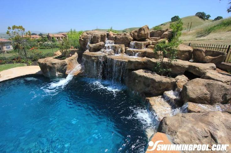 Pools With Slides And Waterfalls Backyard this large lagoon style pool is equipped with natural rock
