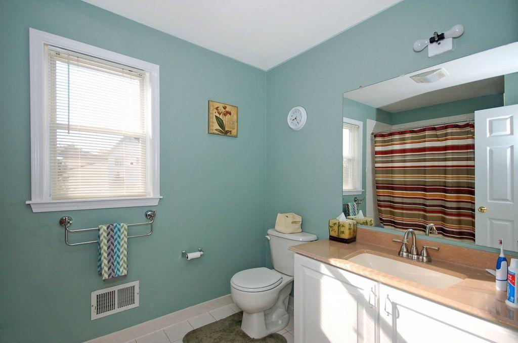 Traditional Full Bathroom with Limestone, Flush, Limestone counters, tiled wall showerbath, DuBois Fabric Shower Curtain