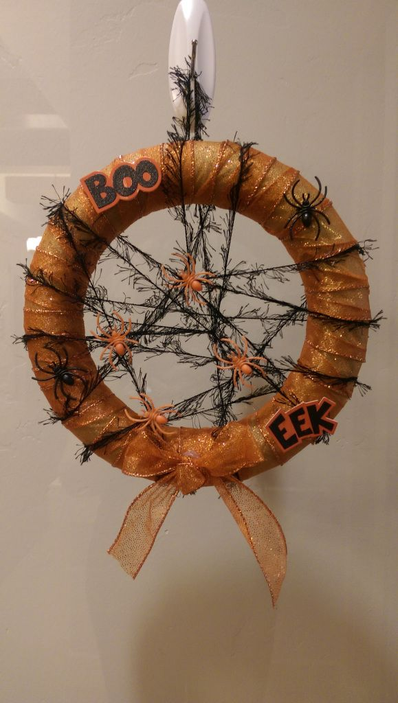 Halloween Spider Web Wreath. Fun and easy to make using mostly dollar store supplies. Cute addition to Halloween décor!