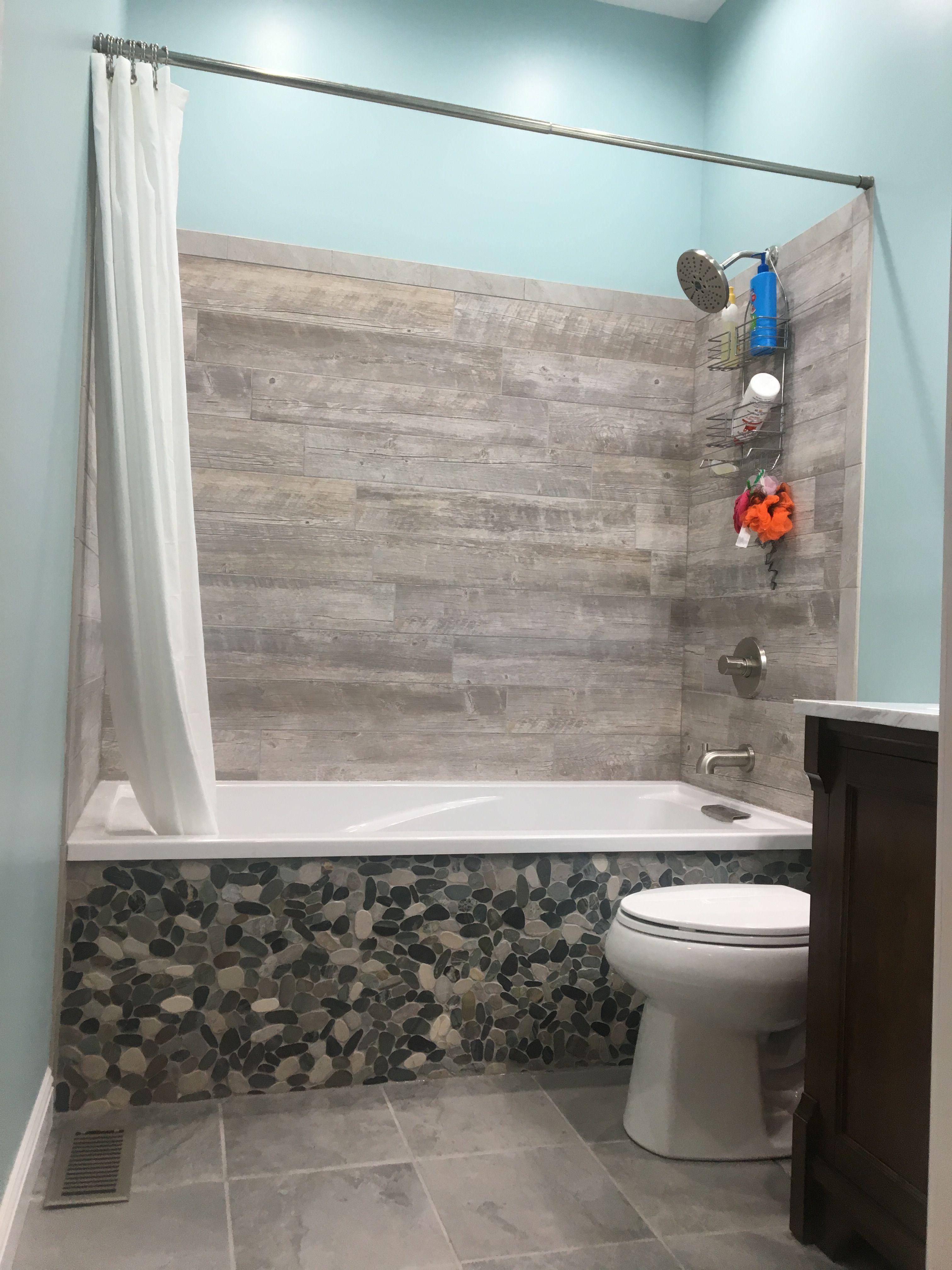 Bathroom Remodel Wood Tile River Rock Tub Front With Images