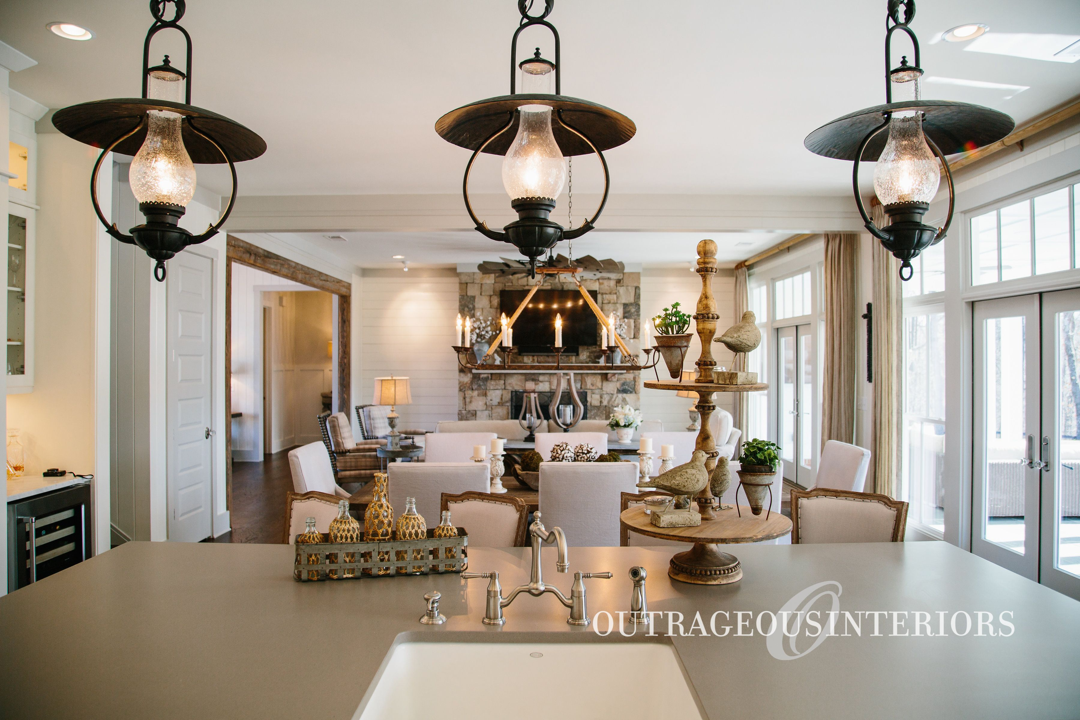 Adding three of the same pendant lights in a row adds trendy style ...