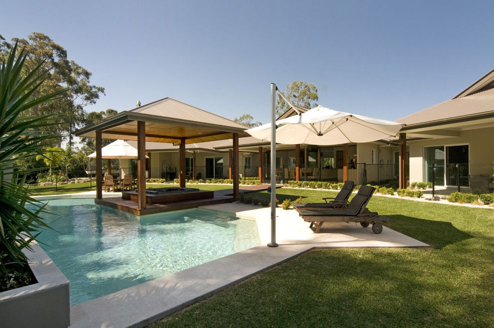 Chic cantilever umbrella in Pool Modern with Concrete Pool Deck