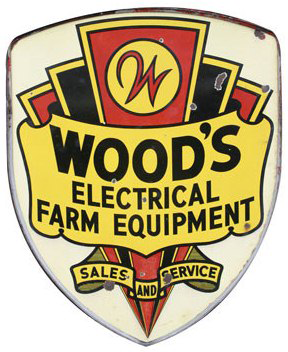 Die-cut Sales & Service sign for Wood's Electrical Farm Equipment.