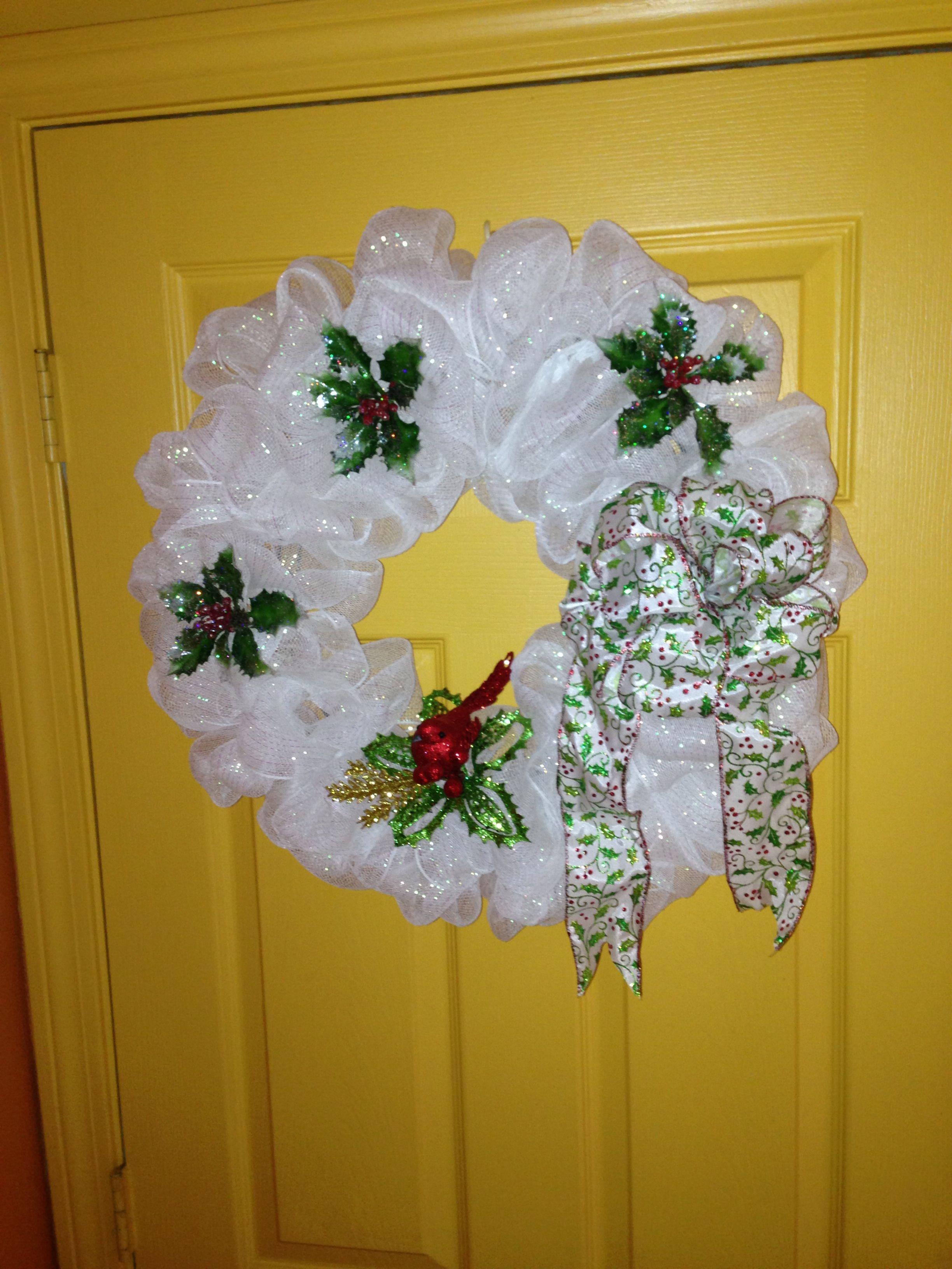 Christmas cardinal-themed deco mesh wreath.