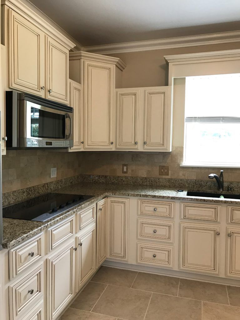 Creamy Off White Painted Kitchen Cabinets With Brown Glaze Gorgeous Granite And Tumbled Travertine Tile Backsplash Color Is Sherwin Williams Steamed Milk