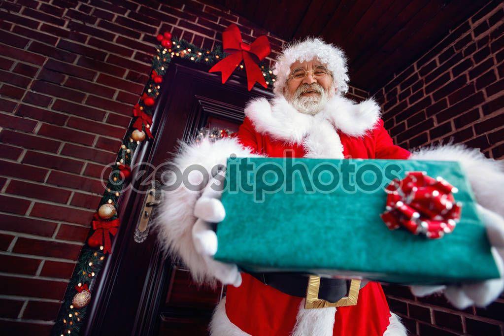 Smiling Santa Claus Giving A Christmas Present Stock Photo Aff Claus Giving Smiling Santa Ad In 2020 Santa Claus Christmas Presents Santa