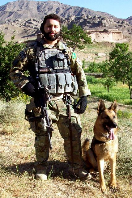 A Security Forces Dog Handler Attached To The Army S 3rd Special