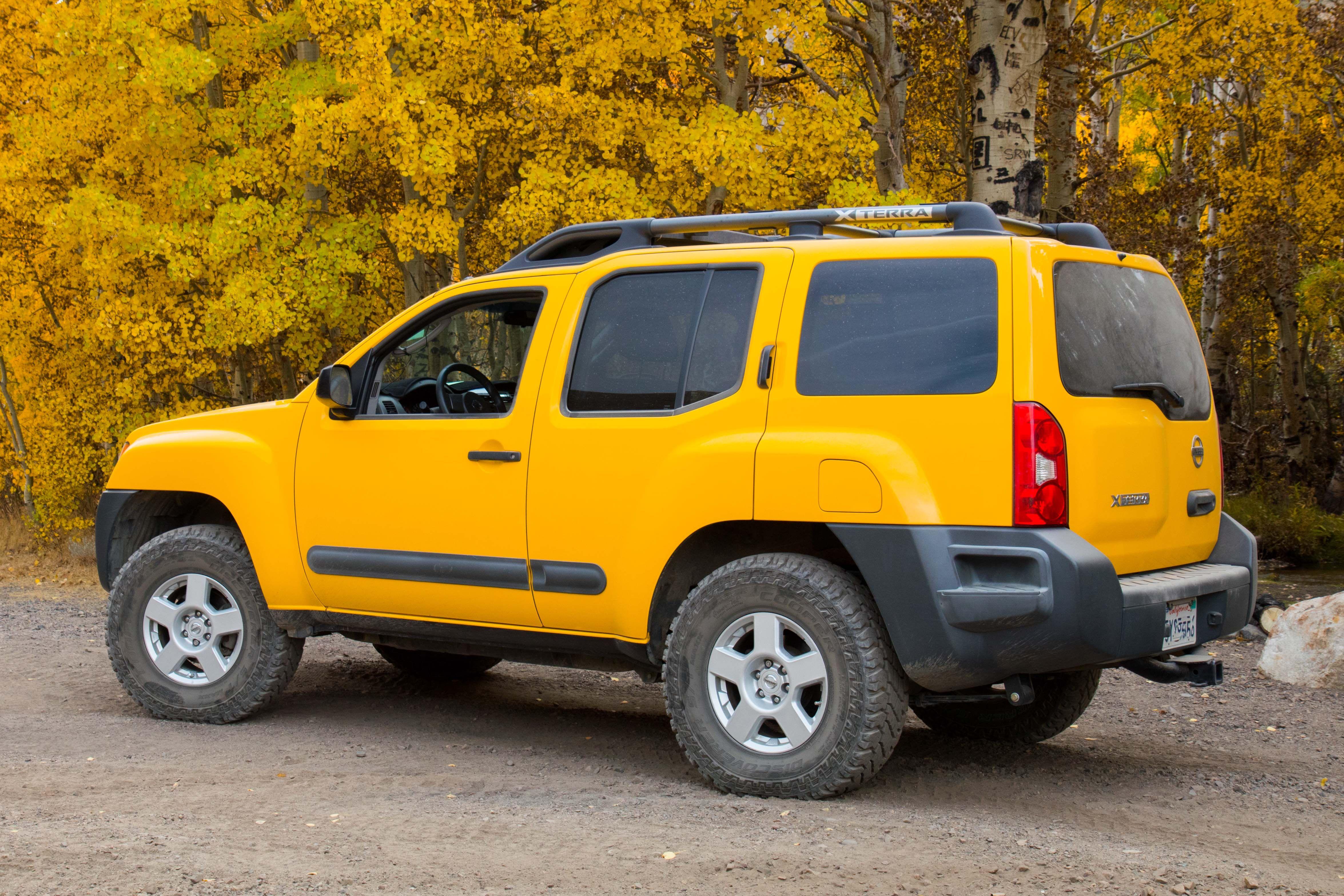 Yellow 2006 Nissan Xterra Cooper ST Maxx Tires at 15 psi near Laurel