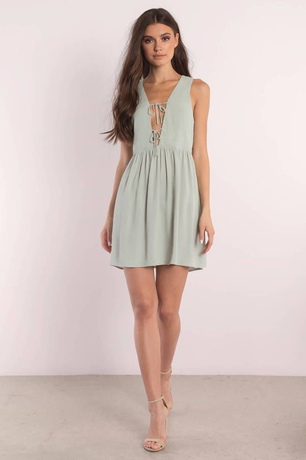 5ab4aa81d3 All lovey dovey in the Amber Sage Plunging Shift Dress. This sleeveless  dress features a