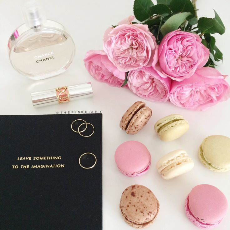 The Pink Diary Macarons Chanel Perfume Black Notebook And Flowers
