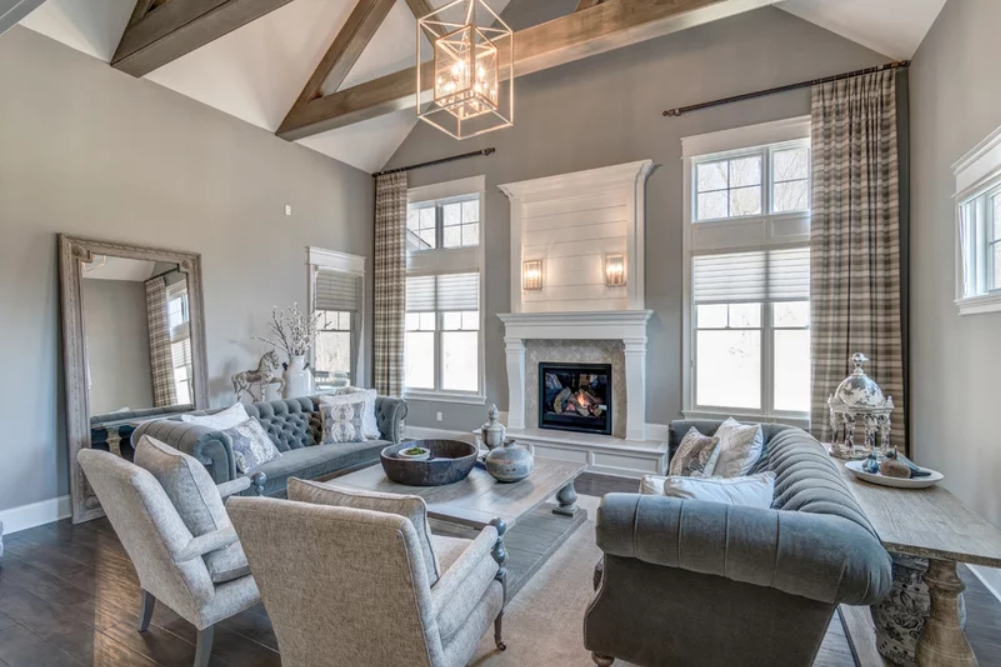 A Gray Palette Takes Center Stage In This Traditional Home Subtle Matte Gray Walls Offer The Perfect In 2020 Living Room Designs Home Interior Design Interior Design #traditional #home #living #room
