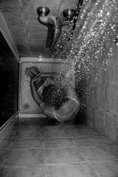 Clothed Figure Sitting In Shower