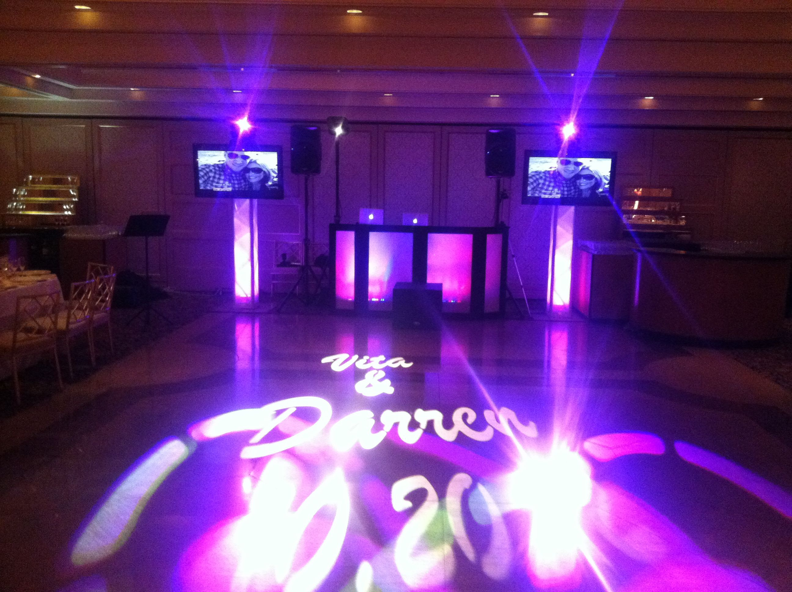 Flat Screen TV's displaying Montage, projected monogram, along with moving heads.