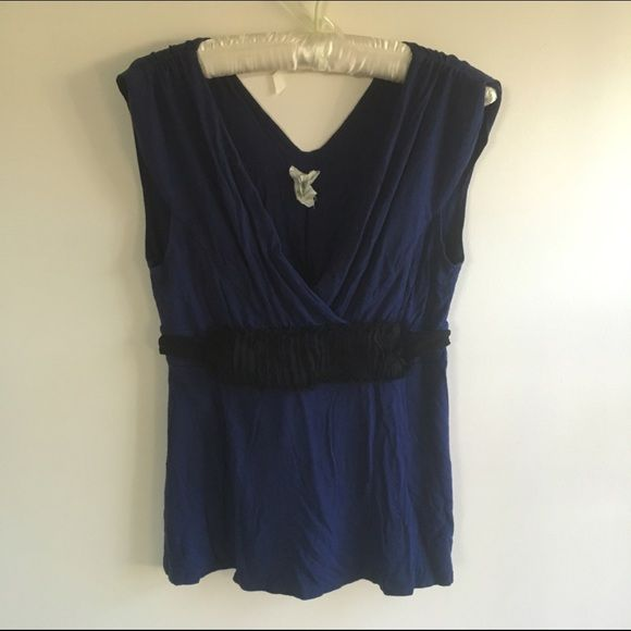Blue sleeveless top by Anthropologie Navy Blue sleeveless top with black tie and front ruffle detail. Anthropologie Tops Blouses