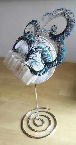 A personal favourite from my Etsy shop https://www.etsy.com/uk/listing/281437404/fascinator-hat-for-weddings-races-and