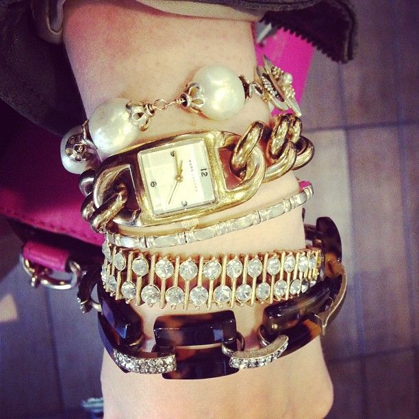 Looks like an arm party is going on here. We love all of these bracelets! #jewelry #gold