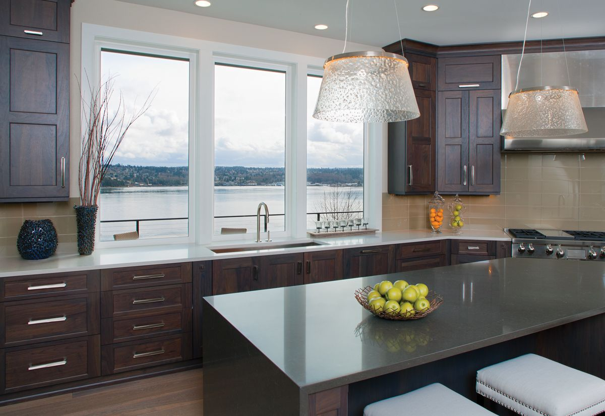 this pacific northwest home uses large windows in the kitchen to overlook the water views on kitchen interior with window id=50463