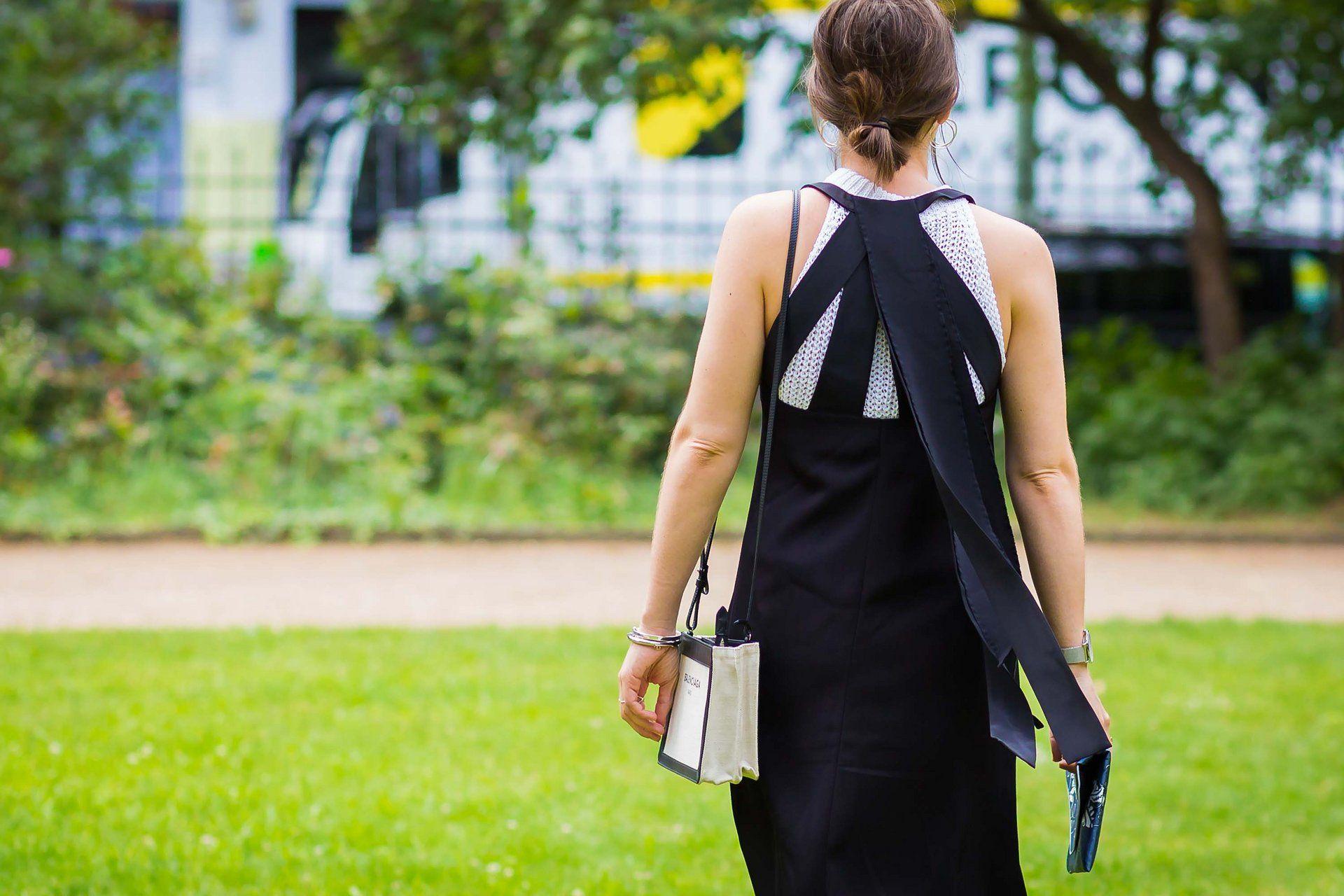 With a Balenciaga bag