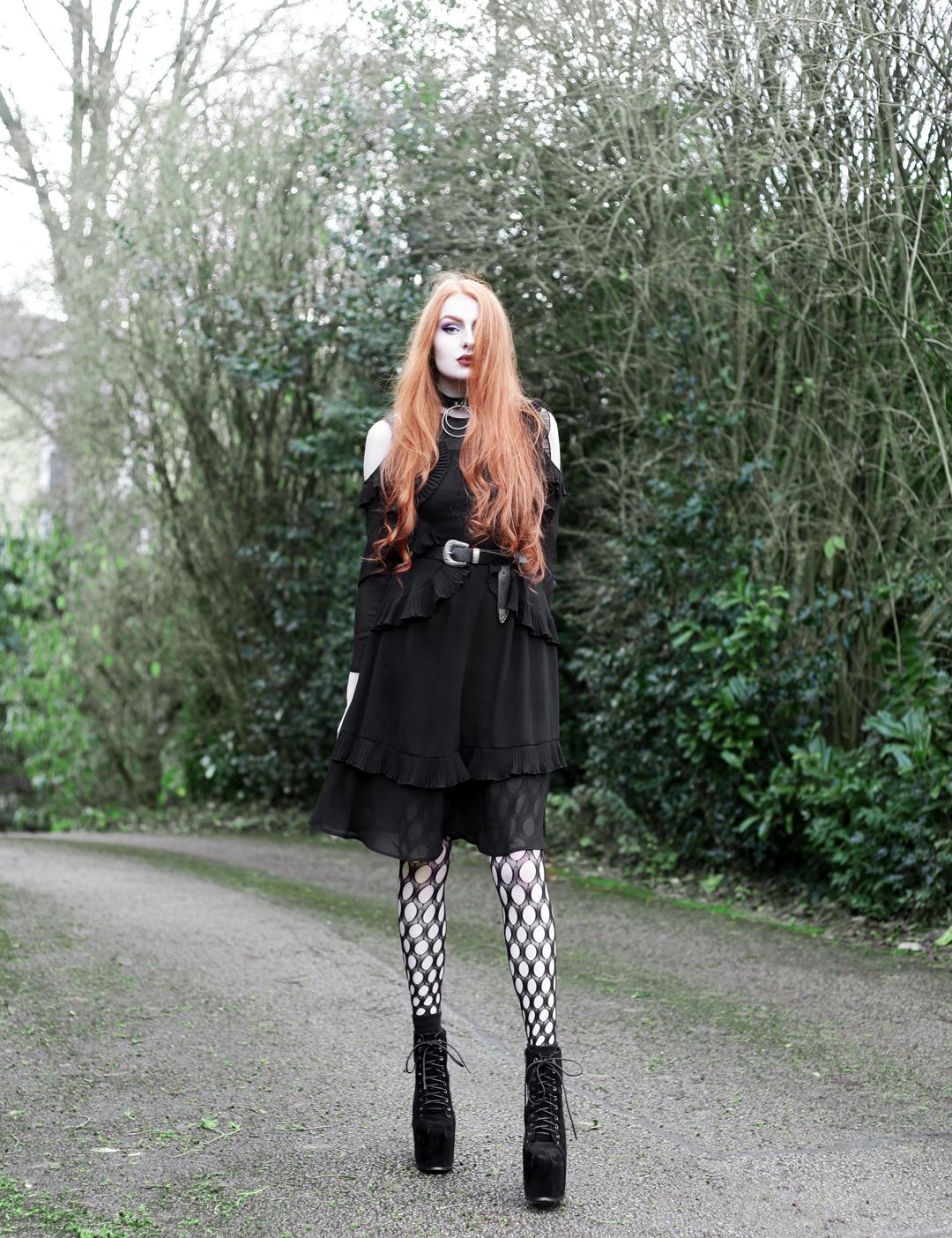 9a763fe731f Olivia Emily wears Asos black ruffle midi dress