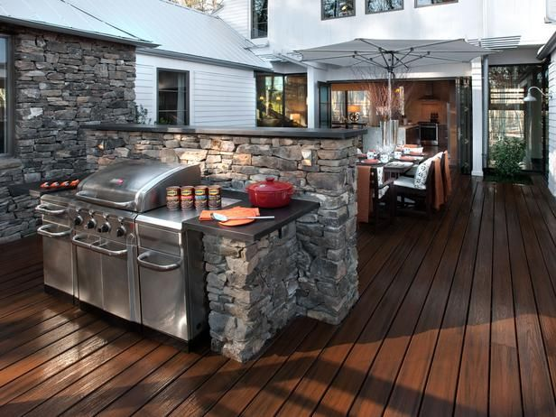Love The Stonework And Dark Wood Deck And My Bf Would Looove The Amazing Grill Setup Outdoor Kitchen Plans Outdoor Kitchen Countertops Outdoor Kitchen Bars