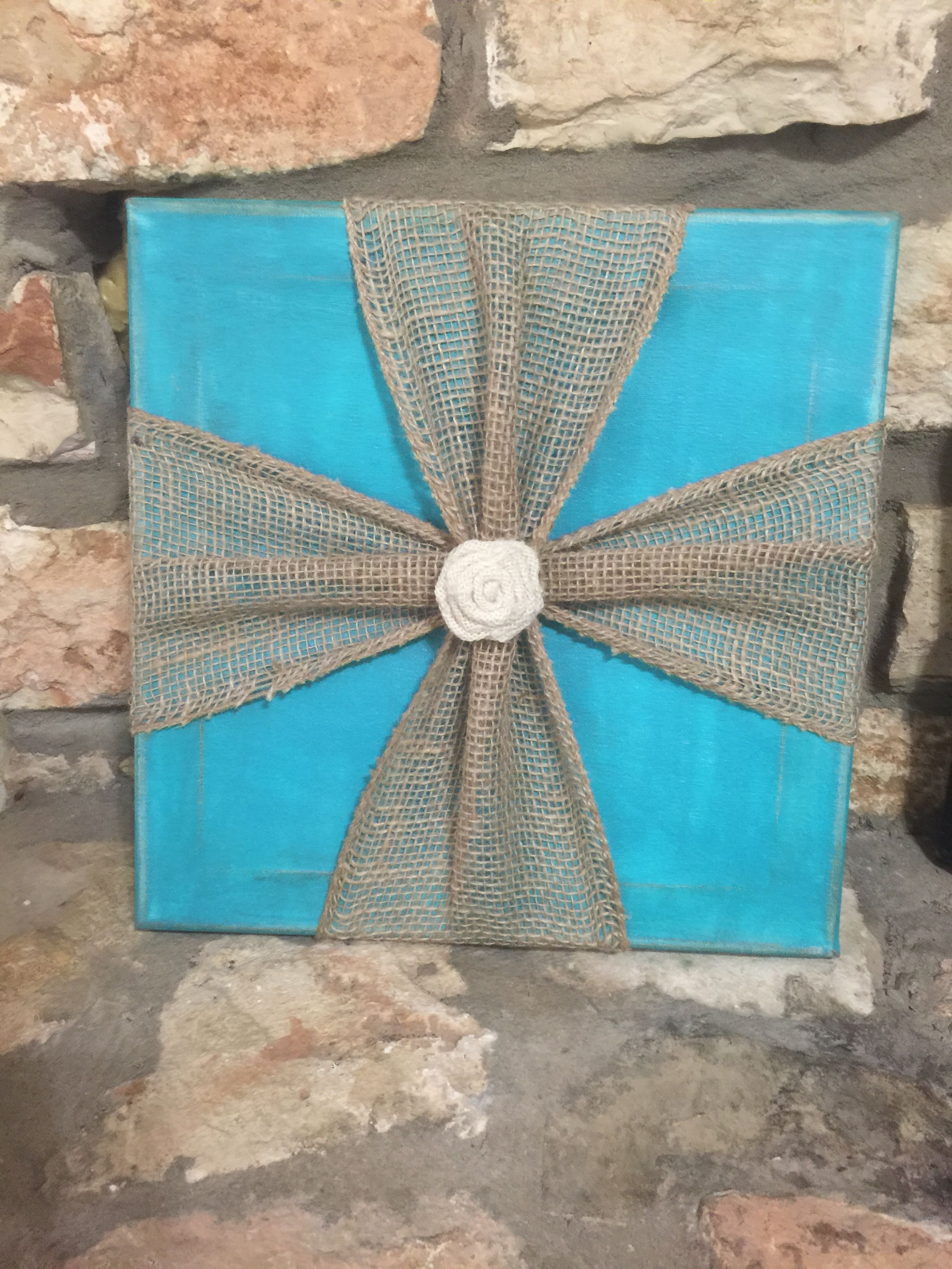 Distressed painted turquoise canvas with burlap ribbon