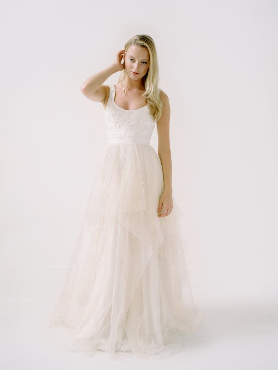 A Lace Wedding Dress With A Tulle Waterfall Skirt And Scoop Neck