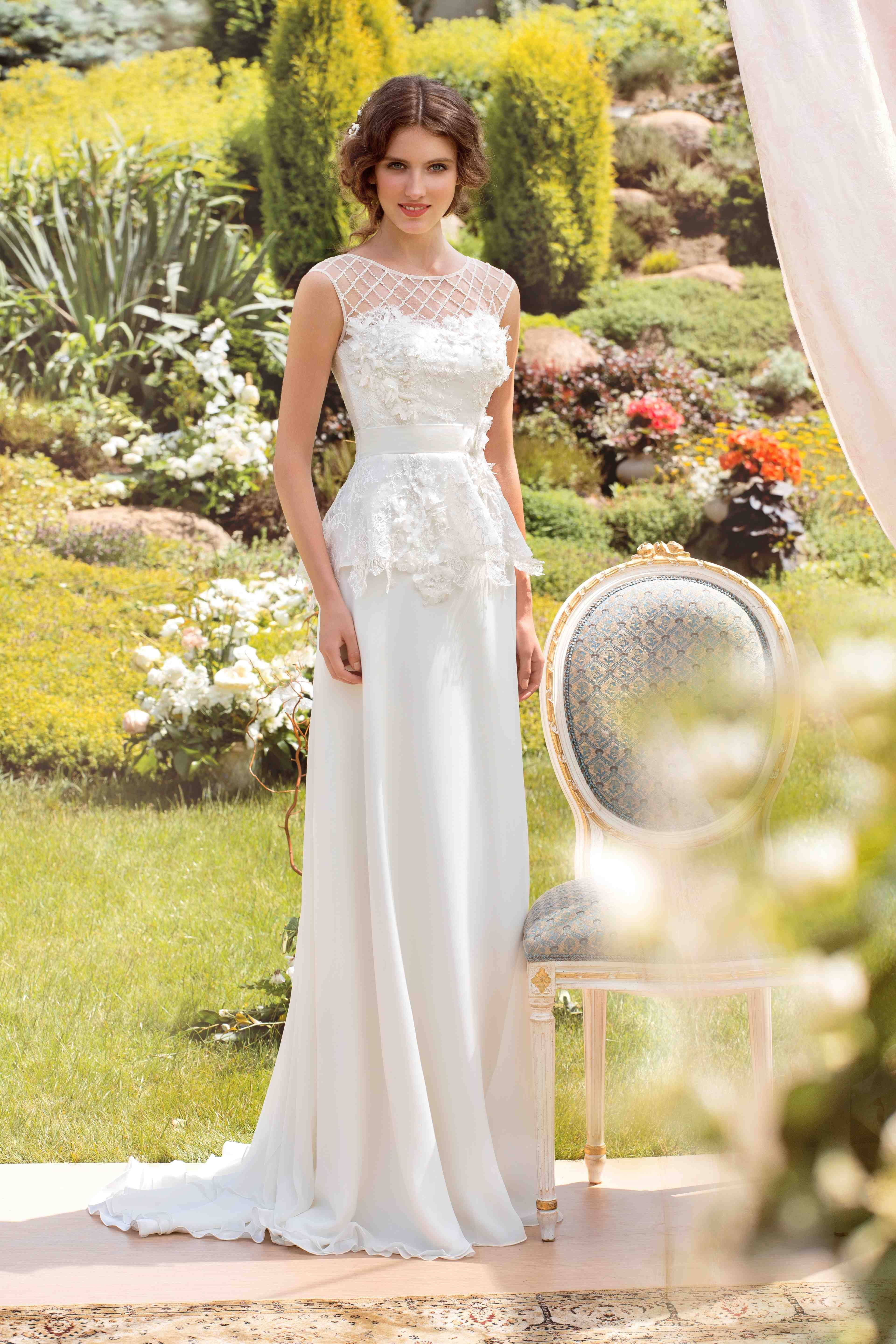 Cap sleeve peplum wedding gown with lace bodice and latticed