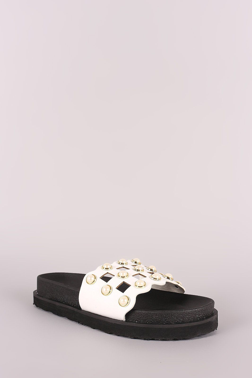 b457b6243cd These slide sandals feature a cutout grid design vamp with faux pearls  accent