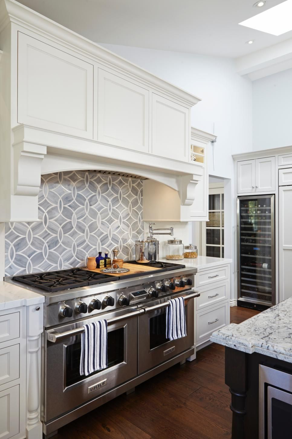 Geometric Gray And White Tile Provide A Modern Backsplash Above