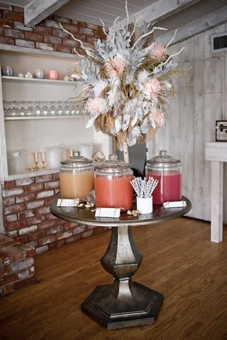 cool centerpiece. Feather, white spray painted twigs (we could use birch) and frayed burlap